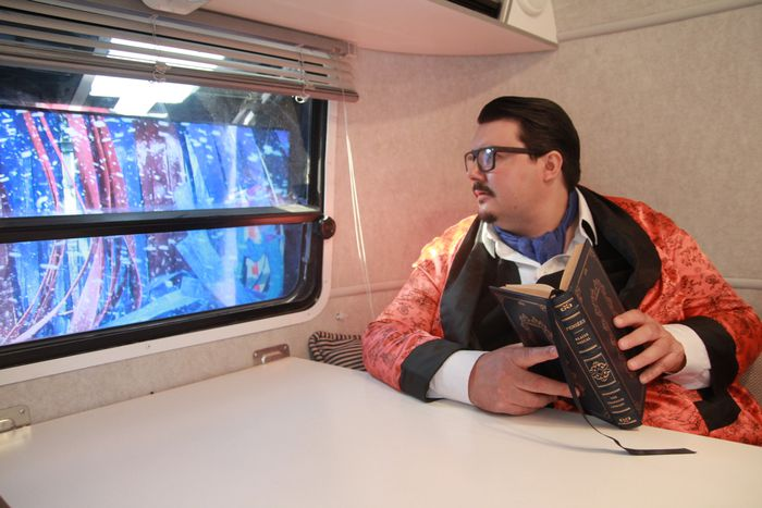 "Bobby Gutierrez as the father in Chapter 18 looks out the AirStream window at the ""car wash\"""
